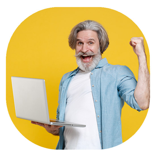 Man with beard holding laptop